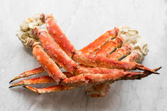 Snow Crab Legs on a light marble. Selective focus Stock Images