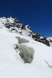 Snow crack and high peaks Royalty Free Stock Photos