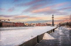 Snow at the Crimean waterfront. Crimean embankment and the monument to Peter the Great on sunset sky Stock Photo