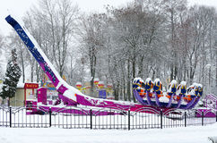 Snow-crowned attraction Zodiac in winter park during snowfall Stock Images