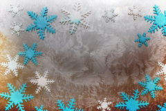Snow crystals. In different colors on an iced surface Royalty Free Stock Photography