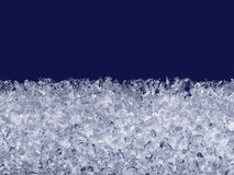 Snow crystals melt on the window. Royalty Free Stock Image