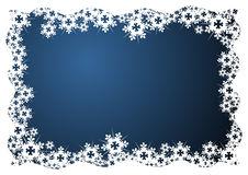 Snow crystals over blue Stock Photography