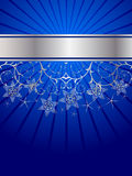 Snow crystals pattern. Over blue and silver background Royalty Free Stock Photos