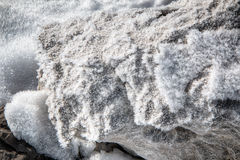 Snow crystals on a rock. In mountains of Italy Stock Photo