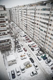 Snow day. Blocks of flats and cars on a snowy day Stock Photography
