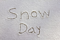 Snow Day. Written in newly fallen snow Stock Photos