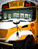 Snow Day School Bus. The front end of a parked snow covered school bus Stock Images