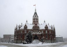 Snow day at Stratford City Hall, Ontario. National Historic Site of Canada Jacobean Queen Anne Revival styled Stratford City Hall during a snow storm, Ontario royalty free stock photos