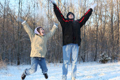Snow Day Winter Excitement. Mother and Daughter Celebrating Their Time Together Throwing Snow in the Air While Laughing and Jumping Stock Photo