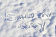 Snow Day written in fresh snowfall Stock Image
