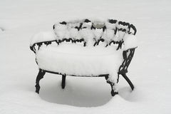 Snow on Deck Chair. Heavy Snow on Metal Deck Chair Royalty Free Stock Photo