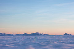 Snow desert and blue winter sky. Mountains on the horizon. Snow desert and blue sky, mountains on the horizon stock photo