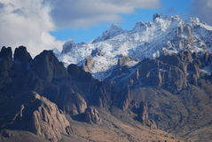Snow on desert mountains royalty free stock images