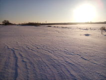 Snow desert. And sun Royalty Free Stock Photos