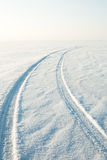 Snow desert and the tracks of the car in the snow. Snow desert and the tracks of the car in snow Royalty Free Stock Photography
