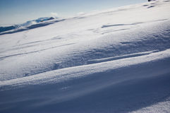 Snow diagonal. Snow patterns. Result of influence of a wind and the sun Royalty Free Stock Photos