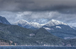 Snow on distant hills on Vancouver Island, BC, Canada Royalty Free Stock Images