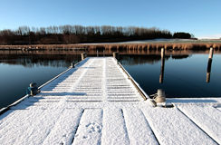 Snow on dock. White snow covering the dock on the water stock images