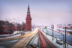 Snow does not interfere with the movement of cars. In the early morning at the Kremlin wall Stock Images