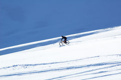 Snow downhill on bike Stock Photo