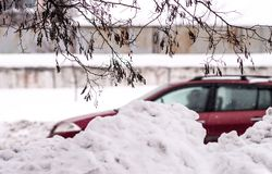 Snow drift along the road. Winter urban view stock images