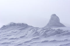 Snow drift at top of mountain Stock Image