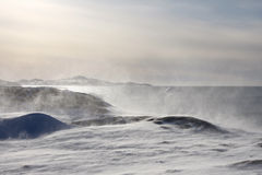 Snow drifting on the Greenland coast Stock Photo