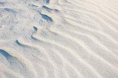Snow drifts. Photo of pile of snow drifted by wind Royalty Free Stock Photos