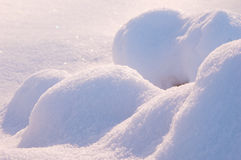Snow drifts. Photo of pile of snow drifted by wind Stock Images