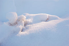 Snow drifts. Photo of pile of snow drifted by wind Stock Photo