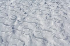 Snow drifts on frozen lake Royalty Free Stock Images