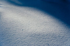 Snow drifts last rays of the sun Stock Image