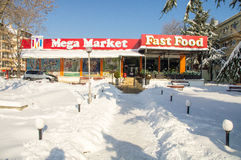 Snow drifts near the central supermarket in Bulgarian Pomorie, winter 2017 Stock Photography