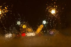 Snow with droplets on the car glass at night Royalty Free Stock Photos