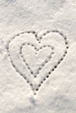 Snow with drown heart shape. Stock Photo