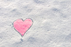 Snow with drown pink heart shape. Stock Images