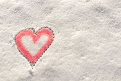 Snow with drown red heart shape. Royalty Free Stock Image
