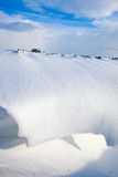 Snow dune in a ditch Stock Image