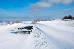 Snow dunes at a lake in Winter Royalty Free Stock Photography