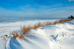 Snow dunes at a lake in Winter Royalty Free Stock Images