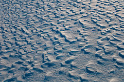 Snow dunes on the surface of the field. Stock Images