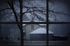 Snow At Dusk Through Wondow. Watching the snow storm through a window in Virginia Royalty Free Stock Photo