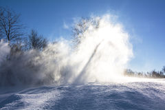 Snow dust and blue sky background Stock Image