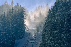 Snow dust. Both ways to get to the top, either use the train or a chairlift Royalty Free Stock Image