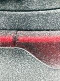 Snow dust on the car. Snow dust on the tail lamp of a car Royalty Free Stock Photos