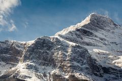 Snow dusted mountaintop in Banff National Park, Canada royalty free stock images