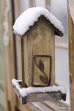Snow on an Empty Bird Feeder Stock Photos