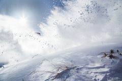 Snow explosion on mountains Stock Images