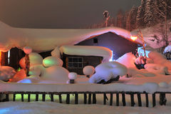 Snow fairy tale world. China northeast snow country, the cold snow, heavy snow pressure in the cabin, lights of the mapping as the fairy tale world Royalty Free Stock Image